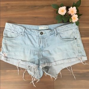 GUESS distressed cut off shorts
